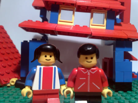Lego couple with derelict house to renovate.